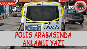 POLİS ARABASINDA ANLAMLI YAZI