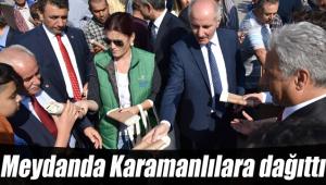 Meydanda Karamanlılara dağıttı