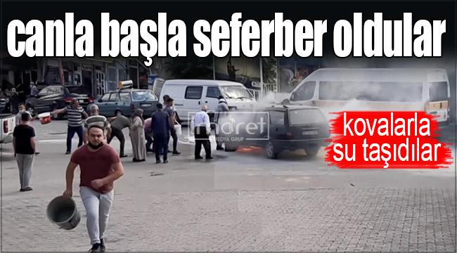 Karaman'da yanan otomobili söndürmek için kovalarla su taşıdılar